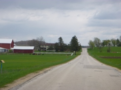 Wisconsin farm country. Red barns and dairy cows.