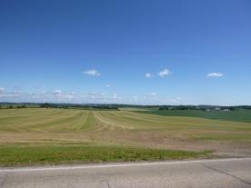 Fields and sky.