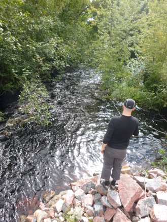 Nate fishing the flooded creek.