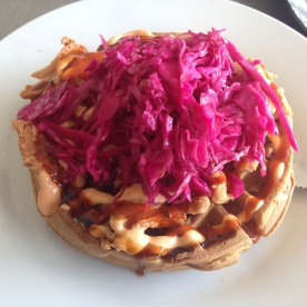 Korean chicken waffle with red cabbage slaw.