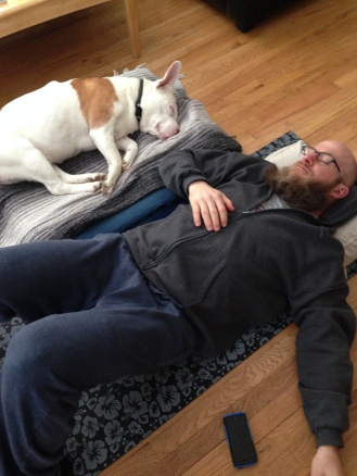 Recovering from my back injury with the help of the old lady dog.
